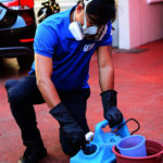 Prepared (PPE) Personal protective equipment and pour insectticides into the misting machine